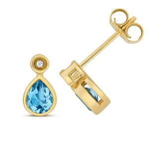Diamond and Pear Shaped Blue Topaz Stud Earrings in 9ct Yellow Gold