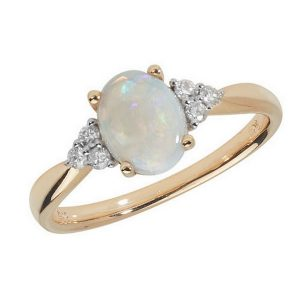 Diamond and Oval Shaped Opal Ring with Diamond Accents in 9ct Yellow Gold