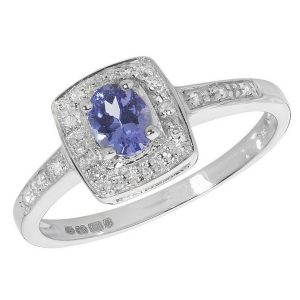 Diamond and Oval Shaped Tanzanite Set 9ct White Gold Ring with Diamond Set Shoulders