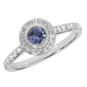Diamond and Tanzanite Rubover Ring with Diamond Set Shoulders in 9ct White Gold