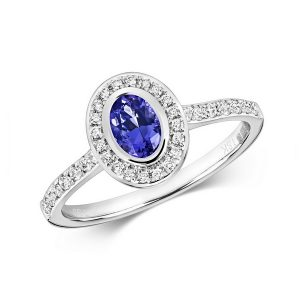 Diamond and Oval Tanzanite Rubover Style Ring with Diamond Set Shoulders in 9ct White Gold