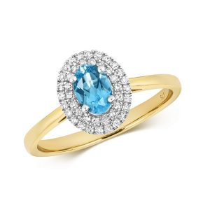 Diamond and Fancy Oval Cut Centre Set Blue Topaz Cocktail Ring in 9ct Yellow Gold