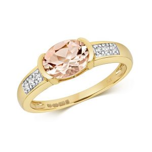 Diamond and Bezel Set Oval Morganite Dress Ring with Diamond Shoulders in 9ct Yellow Gold