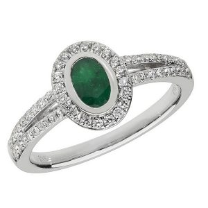 Diamond and Oval Shaped Emerald Cluster Ring with Split Diamond Shoulders in 18ct White Gold