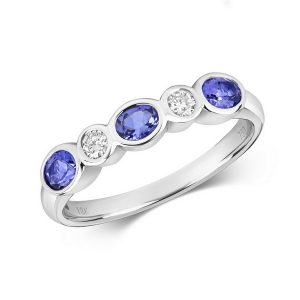 Rubover Set Diamond and Oval Tanzanite Eternity Ring in 18ct White Gold